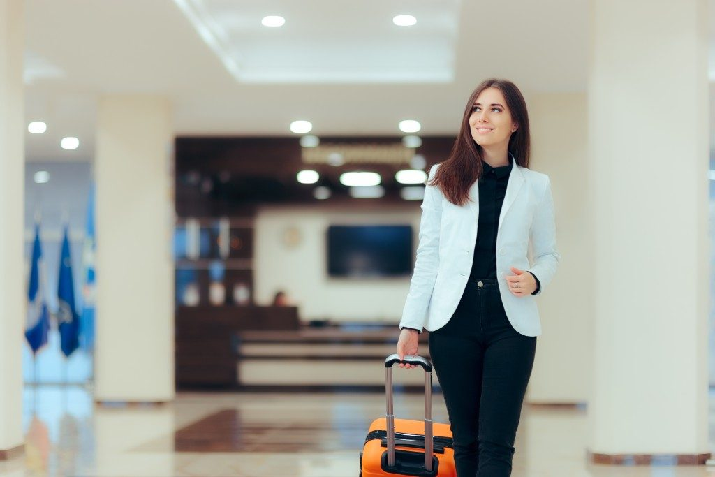 Woman walking with a luggage in the airport