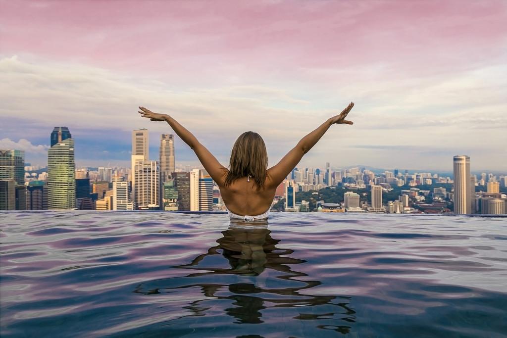 woman on an infinity pool